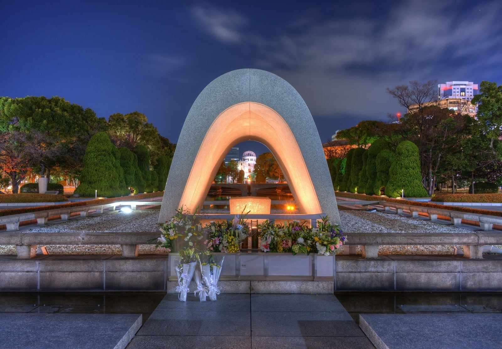 Cenotaph through which the Atomic Dome can be seen at at Peace Memorial Park in Hiroshima, Japan