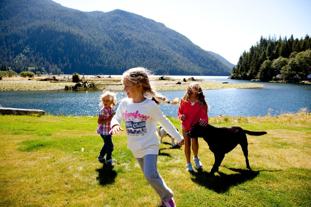 Clayoquot happy little girls dogs ocean lawn
