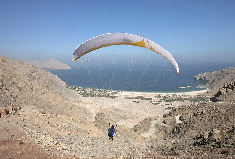 Paragliding towards Zinghy Bay